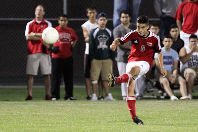 Mike Greene - mgreene@shawmedia.com Huntley's Christian Ramos hits an indirect free kick during a match against Jacobs Tuesday, September 25, 2012 at Jacobs High School in Algonquin. Ramos scored a goal on the kick after Jacobs' goalkeeper touched the ball. Huntley came back from a 2-0 second-half deficit to defeat Jacobs 3-2.