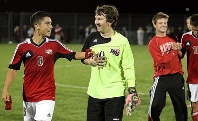 Mike Greene - mgreene@shawmedia.com Huntley's Christian Ramos celebrates with teammate Austen Emery after their team came back from a 2-0 second-half deficit to defeat Jacobs' 3-2 in a match Tuesday, September 25, 2012 at Jacobs High School in Algonquin.