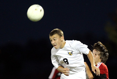 Mike Greene - mgreene@shawmedia.com Jacobs' Chris Rigby headers the ball during a match against Huntley Tuesday, September 25, 2012 at Jacobs High School in Algonquin. Huntley came back from a 2-0 second-half deficit to defeat Jacobs' 3-2.