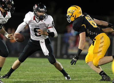 Mike Greene - mgreene@shawmedia.com Huntley quarterback Kameron Sallee is pressured by Jacobs defensive lineman Tim Regan during the first quarter of a game Friday, September 28, 2012 at Jacobs High School in Algonquin. Huntley defeated Jacobs 34-33.