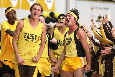 Mike Greene - mgreene@shawmedia.com Cross country members (from left) Julian Lee, Ryan Ross, and Kyle Nelson celebrate while running through a tunnel of cheerleaders during a homecoming pep rally for Jacobs High School Friday, September 28, 2012 in Algonquin. Jacobs lost their homecoming football game to Huntley 34-33.