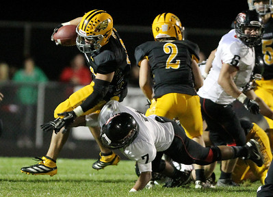 Mike Greene - mgreene@shawmedia.com Jacobs running back Steven Varela is upended by Huntley defensive back Damario Hughes during a rush in the second quarter of a game Friday, September 28, 2012 at Jacobs High School in Algonquin. Huntley defeated Jacobs 34-33.