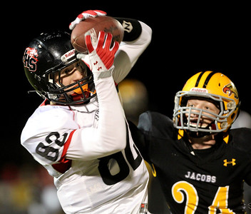 Mike Greene - mgreene@shawmedia.com Huntley wide receiver Jake Lackovic reels in a 78-yard pass for a touchdown while being defended by Jacobs Nick Gierlak during the first quarter of a game Friday, September 28, 2012 at Jacobs High School in Algonquin. Huntley defeated Jacobs 34-33.