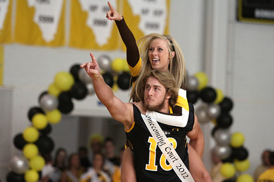Mike Greene - mgreene@shawmedia.com Connor Conzelman and Emilee Sorenson point to the crowd while being introduced for homecoming court during a homecoming pep rally for Jacobs High School Friday, September 28, 2012 in Algonquin.  Jacobs lost their homecoming football game to Huntley 34-33.