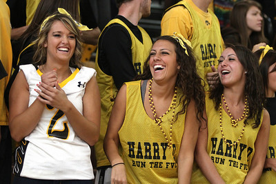 Mike Greene - mgreene@shawmedia.com Kristi Halpin, Payton Berg, and Jaclyn Czech laugh while singing with music being played by a DJ prior to the start of a homecoming pep rally for Jacobs High School Friday, September 28, 2012 in Algonquin.  Jacobs lost their homecoming football game to Huntley 34-33.
