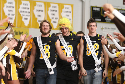 Mike Greene - mgreene@shawmedia.com Connor Conzelman, Adam Kulon, and Nick Starr walk through a cheerleader tunnel during a homecoming pep rally for Jacobs High School Friday, September 28, 2012 in Algonquin.  Jacobs lost their homecoming football game to Huntley 34-33.