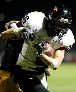 Mike Greene - mgreene@shawmedia.com Huntley wide receiver Bryce Beschorner holds onto a pass while being defended during the fourth quarter of a game against Jacobs Friday, September 28, 2012 at Jacobs High School in Algonquin. Huntley defeated Jacobs 34-33.