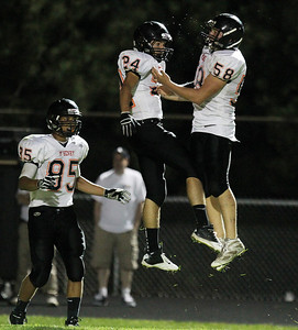 Mike Greene - mgreene@shawmedia.com McHenry wide receiver Korey Partenheimer (left) celebrates with teammate Micah Kohn after scoring a touchdown in the second quarter of a game against Jacobs Friday, September 14, 2012 at Harry D. Jacobs High School in Algonquin. Partenheimer tallied 115 total yards on 4 carries and 3 receptions, scoring three touchdowns in McHenry's 49-42 loss to Jacobs.