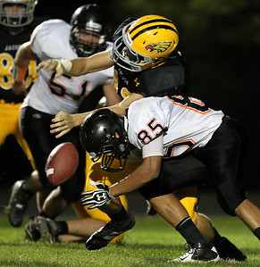 Mike Greene - mgreene@shawmedia.com McHenry defensive back Jake Braskett hits Jacobs running back Dante Petrone after the ball was stripped by McHenry's Nate Rueckemann during a rush in the second quarter of a game Friday, September 14, 2012 at Harry D. Jacobs High School in Algonquin. Jacobs defeated McHenry in a back-and-fourth game 49-42.