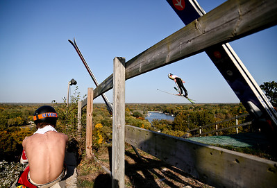 Josh Peckler - Jpeckler@shawmedia.com Trevor Edlund of St. Paul, Minn. watches as a ski jumper flies by during the 27th Annual Norge Summer Ski Jump Tournament in Fox River Grove, Saturday, September 29, 2012.