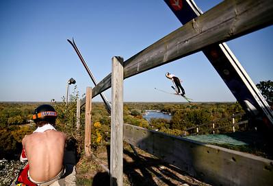 Josh Peckler - Jpeckler@shawmedia.com Trevor Edlund of St. Paul, Minn. watches as a ski jumper flies by during the 27th Annual Norge Summer Ski Jump Tournament in Fox River Grove, Saturday, September 29, 2012.