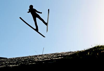 Josh Peckler - Jpeckler@shawmedia.com A skier flies through the air during the 27th Annual Norge Summer Ski Jump Tournament in Fox River Grove, Saturday, September 29, 2012.