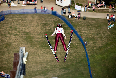 Josh Peckler - Jpeckler@shawmedia.com Sabina Gasienica performs her jump during the 27th Annual Norge Summer Ski Jump Tournament in Fox River Grove, Saturday, September 29, 2012.