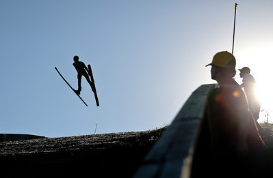 Josh Peckler - Jpeckler@shawmedia.com People watch as a skier flies through the air during the 27th Annual Norge Summer Ski Jump Tournament in Fox River Grove, Saturday, September 29, 2012.