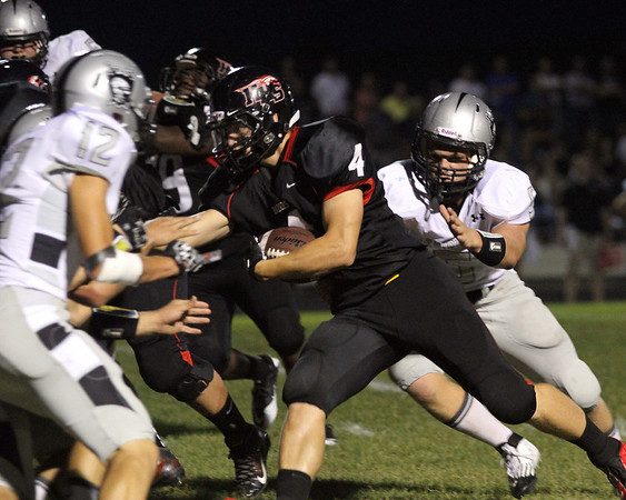 Don Lansu / For the Northwest Herald<br /> Huntley running back Ethan Connor (4) picks up short yardage before being brought down by Kaneland defenders Gary <br /> Koehring (5) and John Pruett (12)in the second quarter in Huntley