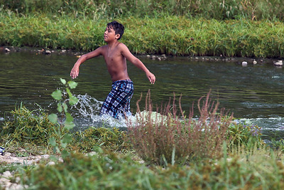 Sarah Nader - snader@shawmedia.com Raul Hernandez, 11, of Carpentersville  swims in the Fox River while enjoying Labor Day at Cornish Park in Algonquin on Monday, September 3, 2012.