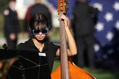 Mike Greene - mgreene@shawmedia.com McHenry High School band member Paige Wolkober, 16, practices before performing Tuesday, September 11, 2012 before the start of a 9/11 ceremony at Veterans Memorial Park in McHenry. The ceremony included the raising of a flag that flew across the street from where Tower 2 of the World Trade Center stood and a moment of silence at 9:05 a.m. marking the time when the South Tower collapsed.