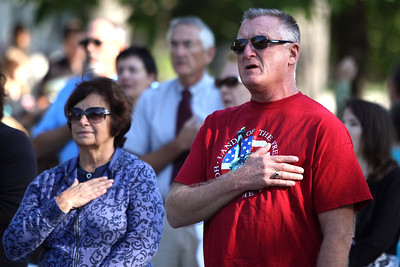 Mike Greene - mgreene@shawmedia.com Navy Veteran Larry Breidenbach, of McHenry, joins the crowd in singing the Pledge of Allegiance during a 9/11 ceremony at Veterans Memorial Park Tuesday, September 11, 2012 in McHenry. The ceremony included the raising of a flag that flew across the street from where Tower 2 of the World Trade Center stood and a moment of silence at 9:05 a.m. marking the time when the South Tower collapsed.