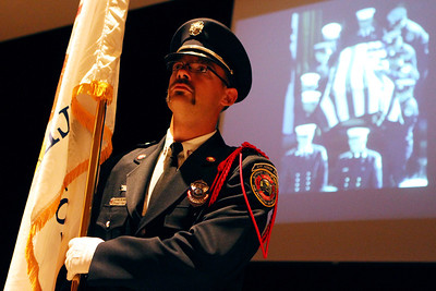 Mike Greene - mgreene@shawmedia.com Algonquin-Lake in the Hills Fire Protection District Honor Guard member Frank Pelanek stands at attention while presenting the Illinois state flag Tuesday, September 11, 2012 at Jacobs High School in Algonquin. Members of local and regional fire departments spoke during a remembrance for victims of the 9/11 attack.