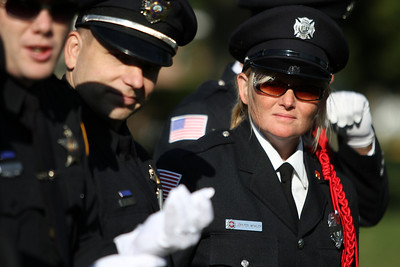 Mike Greene - mgreene@shawmedia.com McHenry Township Fire Protection District Honor Guard commander Jenny Winkler listens to instructions Tuesday, September 11, 2012 before the start of a 9/11 ceremony at Veterans Memorial Park in McHenry. The ceremony included the raising of a flag that flew across the street from where Tower 2 of the World Trade Center stood and a moment of silence at 9:05 a.m. marking the time when the South Tower collapsed.