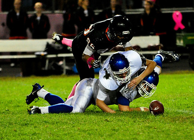 Josh Peckler - Jpeckler@shawmedia.com McHenry's Jake Braskett (85) jumps over two Dundee-Crown players to try and recover a fumble during the second quarter in McHenry Friday, September 7, 2012.