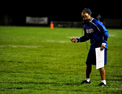 Josh Peckler - Jpeckler@shawmedia.com Dundee-Crown football coach Vito Andriola yells at a referee during the second quarter against Mchenry Friday, September 7, 2012.