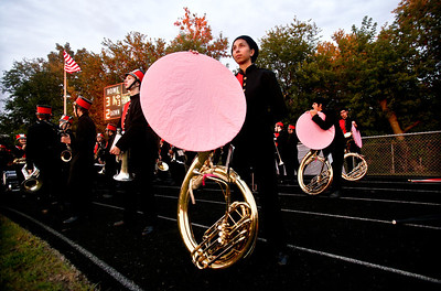 Josh Peckler - Jpeckler@shawmedia.com McHenry High School marching band member Caylin Kaumas has a pink cover over her tuba for the Pink-Out Play For a Cure Week to bring awareness to cancer in women in McHenry Friday, September 7, 2012.