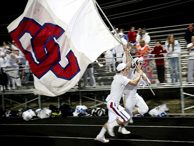 Josh Peckler - Jpeckler@shawmedia.com Dundee-Crown students Clayton Eberly (no glasses) and Dylan Kissack run with the Dundee-Crown flag after the Charger scored a touchdown in the second quarter in McHenry Friday, September 7, 2012.