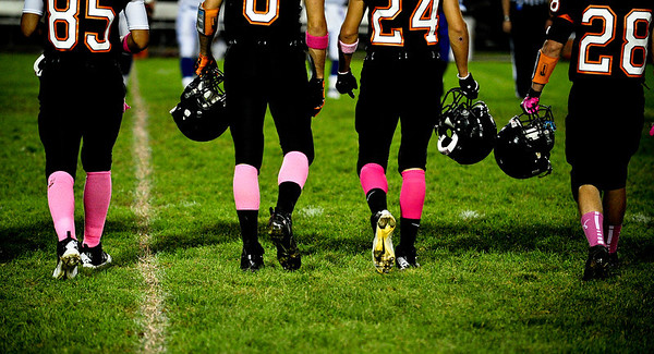 Josh Peckler - Jpeckler@shawmedia.com The captains of McHenry's football team head to midfield wearing pink socks for the Pink-Out Play For a Cure Week to bring awareness to cancer in women.     in McHenry Friday, September 7, 2012.