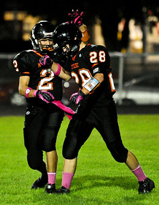 Josh Peckler - Jpeckler@shawmedia.com McHenry's Adam Mattson (2) congratulates teammate John Kontantelos on scoring a touchdown during the first quarter in McHenry Friday, September 7, 2012.
