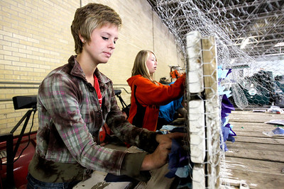 "Mike Greene - mgreene@shawmedia.com McHenry West High School freshman Katie Harris, 14, stuffs chicken wire with colored tissue paper during a float building event for McHenry High School's Homecoming Monday, October 1, 2012 at the City Garage in McHenry. A parade, with this year's theme of ""Wish Upon a Star,"" will be held Friday, October 5 at 2PM before McHenry faces Johnsburg in a home football contest."