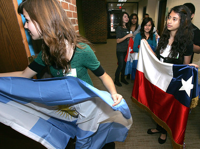 H. Rick Bamman - hbamman@shawmedia.com Woodstock North students Pami Padilla (left) and Maria Sanchez carry the colors of Argentina and Chile, as they enter the stage during the parade of flags at the opening of the Latino Empowerment Conference at McHenry County College. More than 200 high school students from 10 local high schools will participated in the conference that is in its second year. © Northwest Herald