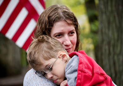 Josh Peckler - Jpeckler@shawmedia.com Katie Cook of Prairie Grove holds her son Conor, 3 after playing outside at their home in Prairie Grove. © Northwest Herald