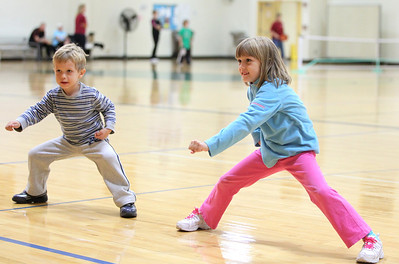"Mike Greene - mgreene@shawmedia.com Oliver Bajkiewicz, 4 of Lake in the Hills, and his sister Victoria, 6, try out martial arts moves during the Huntley Park District's first ""Worldwide Day of Play.""  © Northwest Herald"