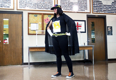 Sarah Nader - snader@shawmedia.com Becca Gurba, 16, of Crystal Lake is dressed like a superhero while waiting in the lunch line at Crystal Lake South High School. Students were encouraged to dress in their favorite superhero costumes in celebration of homecoming week. © Northwest Herald