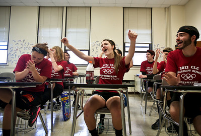 Josh Peckler - Jpeckler@shawmedia.com Crystal Lake Central freshman Amanda Ricca (center) celebrates her team winning a round of Family Feud during the Crystal Lake Central High School Homecoming Olympics. © Northwest Herald