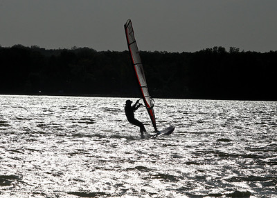 Josh Peckler - Jpeckler@shawmedia.com A man wind surfs on McCullom Lake in McHenry. Strong winds could be felt through out Mchenry County Wednesday with wind gust reaching close to 30 miles per hour. © Northwest Herald