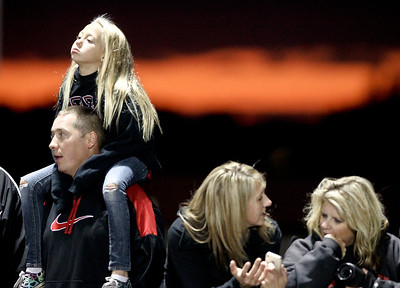 Josh Peckler - Jpeckler@shawmedia.com Riley O'Mare, 8 of Huntley sits on the shoulders of her dad Brian as they watch Huntley and Dundee Crown play at Huntley High School.  © Northwest Herald