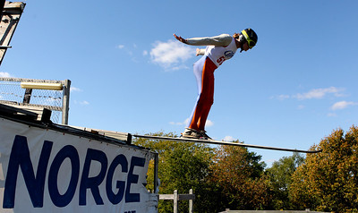 Mike Greene - mgreene@shawmedia.com Gabriella Armstrong, of the NYSEF Ski Club, flies off the jump while competing in the J1 Women Class during Day 2 of the 27th Annual Norge Summer Ski Jump Tournament Sunday, September 30, 2012 in Fox River Grove.