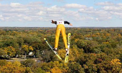 Mike Greene - mgreene@shawmedia.com Ben Kaiser, of the Norge Ski Club, flies through the air while competing in the J1 Class during Day 2 of the 27th Annual Norge Summer Ski Jump Tournament Sunday, September 30, 2012 in Fox River Grove.