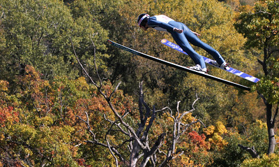 Mike Greene - mgreene@shawmedia.com Michael Glasder, of Cary flies through the air during a competition round in Day 2 of the 27th Annual Norge Summer Ski Jump Tournament Sunday, September 30, 2012 in Fox River Grove.