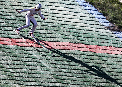 Mike Greene - mgreene@shawmedia.com Zak Hammill, of the Ishpeming Ski Club, lands while competing in the Masters Class during Day 2 of the 27th Annual Norge Summer Ski Jump Tournament Sunday, September 30, 2012 in Fox River Grove.