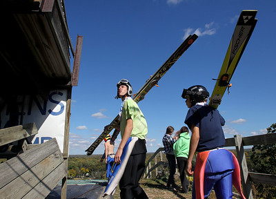 Mike Greene - mgreene@shawmedia.com Karl Schulz, of Lake Placid, NY, watches for competitors on the jump before climbing the stairs during Day 2 of the 27th Annual Norge Summer Ski Jump Tournament Sunday, September 30, 2012 in Fox River Grove.