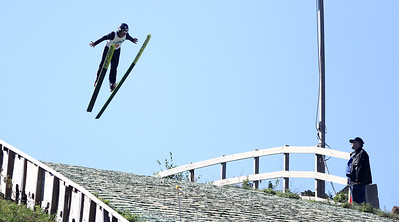 Mike Greene - mgreene@shawmedia.com Albert Gasienica, of the Norge Ski Club, flies through the air while competing in the Masters Class during Day 2 of the 27th Annual Norge Summer Ski Jump Tournament Sunday, September 30, 2012 in Fox River Grove.