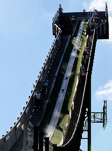 Mike Greene - mgreene@shawmedia.com Competitors make their way up the ski jump during Day 2 of the 27th Annual Norge Summer Ski Jump Tournament Sunday, September 30, 2012 in Fox River Grove.