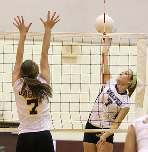 Mike Greene - mgreene@shawmedia.com Prairie Ridge's Taylor Otto (right) goes to spike the ball as Jacobs' Rachel Arceneaux attempts to block the shot during the first set of a conference match Tuesday, September 18, 2012 at Prairie Ridge High School in Crystal Lake. Prairie Ridge (4-0) defeated Jacobs (3-1) in three sets to remain undefeated in the conference.