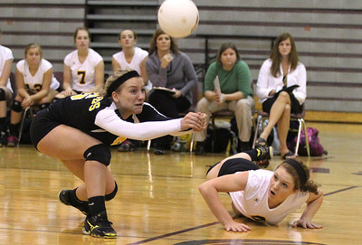 Mike Greene - mgreene@shawmedia.com Jacobs' Kassie Kasper (left) bumps the ball as teammate Alyssa Ehrhardt (right) watches after diving for the shot during the third set of a conference match against Prairie Ridge Tuesday, September 18, 2012 at Prairie Ridge High School in Crystal Lake. Prairie Ridge (4-0) defeated Jacobs (3-1) in three sets to remain undefeated in the conference.