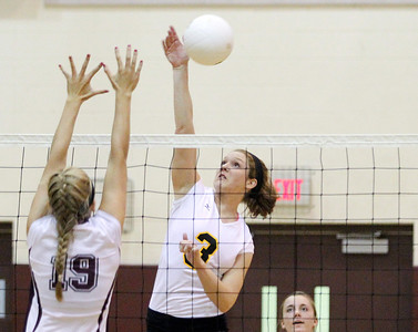 Mike Greene - mgreene@shawmedia.com Jacobs' Alyssa Ehrhardt (right) goes to spike the ball as Prairie Ridge's Alit Witt attempts to block during the second set of a conference match Tuesday, September 18, 2012 at Prairie Ridge High School in Crystal Lake. Prairie Ridge (4-0) defeated Jacobs (3-1) in three sets to remain undefeated in the conference.
