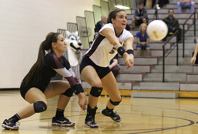 Mike Greene - mgreene@shawmedia.com Prairie Ridge's Nicole Kirchberg (right) goes in front of teammate Paige Dacanay to bump a serve during the first set of a conference match against JacobsTuesday, September 18, 2012 at Prairie Ridge High School in Crystal Lake. Prairie Ridge (4-0) defeated Jacobs (3-1) in three sets to remain undefeated in the conference.