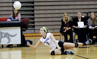Mike Greene - mgreene@shawmedia.com Prairie Ridge's Taylor Otto dives to save the ball during the third set of a conference match against Jacobs Tuesday, September 18, 2012 at Prairie Ridge High School in Crystal Lake. Prairie Ridge (4-0) defeated Jacobs (3-1) in three sets to remain undefeated in the conference.